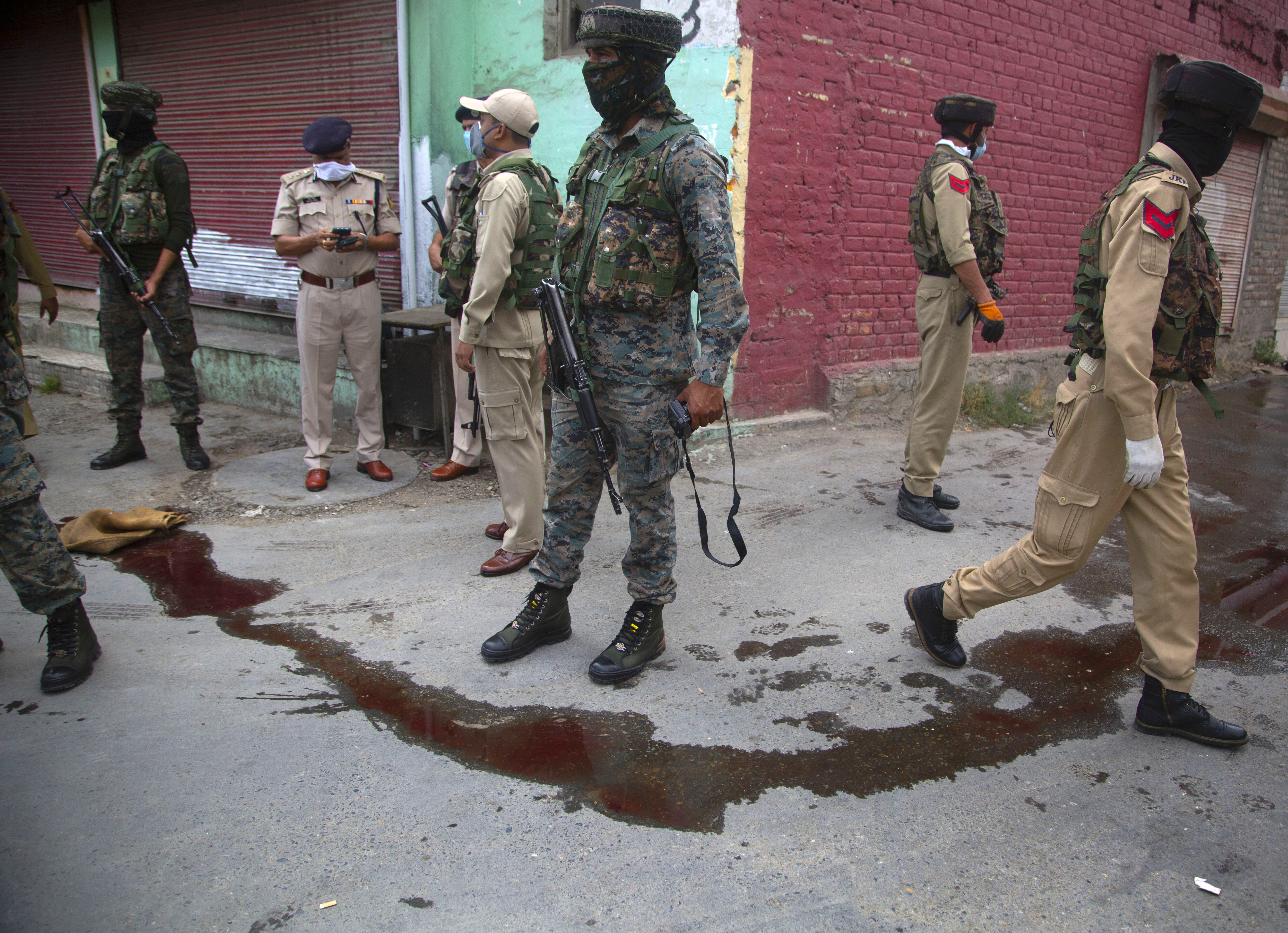 Indian policemen secure the area after suspected rebels attack on policemen on the outskirts of Srinagar, Indian controlled Kashmir, Friday, Aug. 14, 2020. Anti-India rebels in Indian-controlled Kashmir Friday attacked a police party in the disputed region's main city, killing two police officials and injuring another, police said. (AP Photo/Mukhtar Khan)