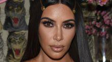 Kim Kardashian accidentally flashes her Spanx