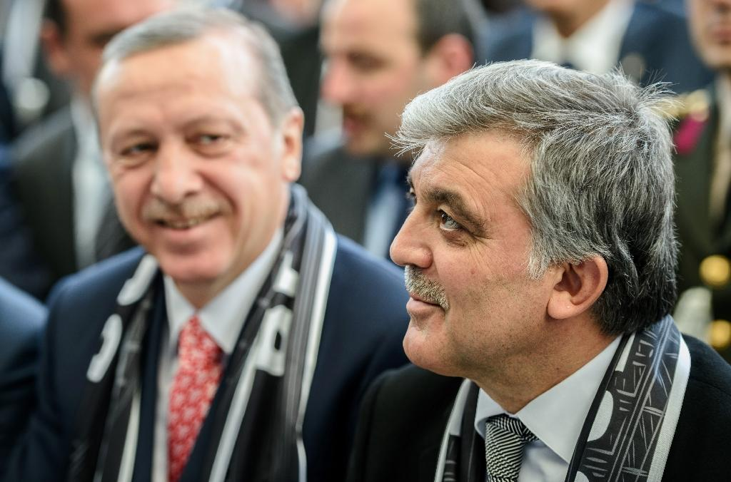 Turkish President Recep Tayyip Erdogan (L) seen here with former Turkish President Abdullah Gul in 2016. Rumours are rife that Gul may run for president in June as a unity candidate (AFP Photo/OZAN KOSE)