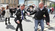 Nigel Farage's milkshake attacker told to pay him compensation