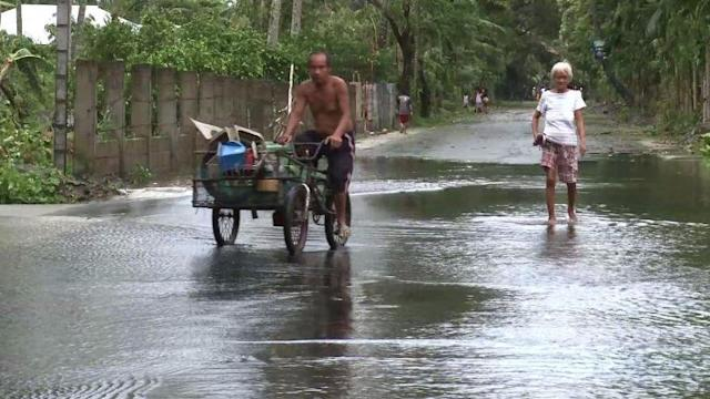 13 dead, millions without power as typhoon hits Philippines