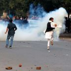Police firing 'live rounds' and tear gas clash with protesters demonstrating against citizenship bill that excludes Muslims in India