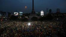 Thai police probe media, as thousands again defy protest ban