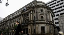 BOJ lifts next year's growth forecast, saves ammunition as virus risks linger