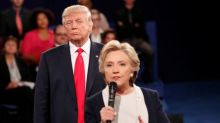 Clinton, in book, says Trump's debate stalking made her skin crawl