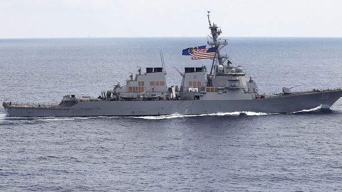10 missing after Navy, merchant ships collide