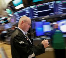 Tobacco and tech drag on Wall Street; yields boost banks