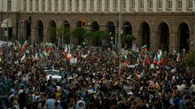 Bulgarian PM sacks three ministers as protesters keep up pressure