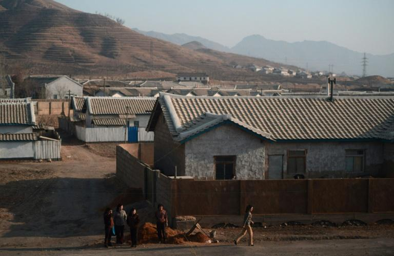 North Korean women are seen from the window of a train at a village along the railway heading from Pyongyang to North Pyongan Province on North Korea's west coast in 2012