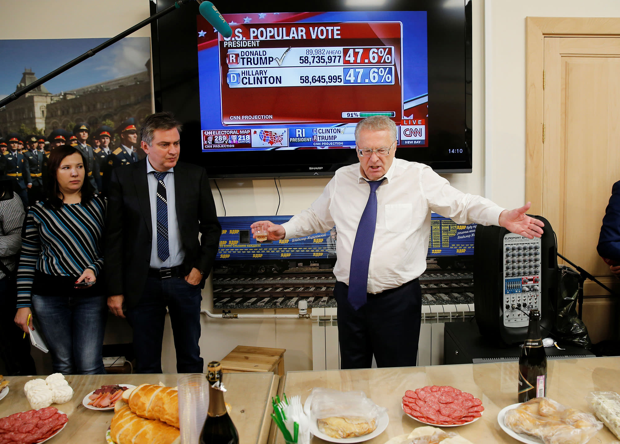 <p>Head of the Liberal Democratic Party of Russia (LDPR) Vladimir Zhirinovsky celebrates Donald Trump's election as president by drinking sparkling wine with other party members during a break in the session of the State Duma, the lower house of parliament, in Moscow, Russia on Nov. 9, 2016.(Photo: Maxim Zmeyev/Reuters) </p>
