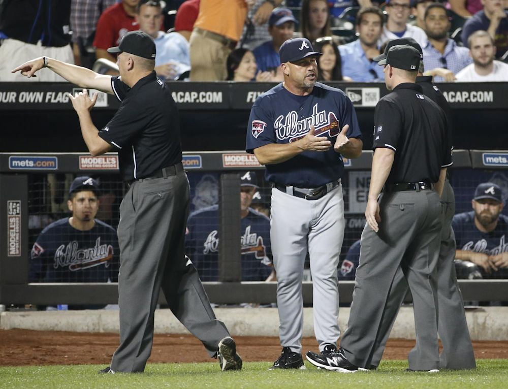 Mike Everitt gives Fredi Gonzalez the heave-ho. (AP)