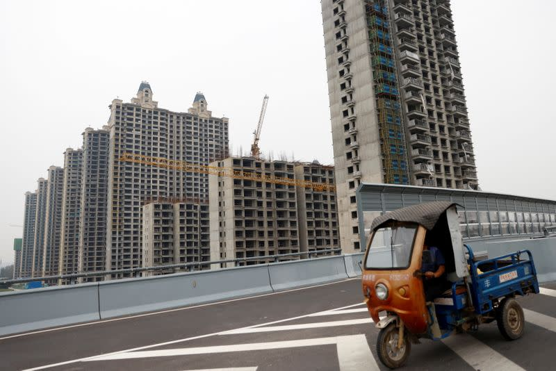 China Evergrande fears grip markets as Beijing stands back, for now