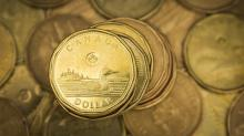 Canadian dollar edges lower as oil and stock prices slide