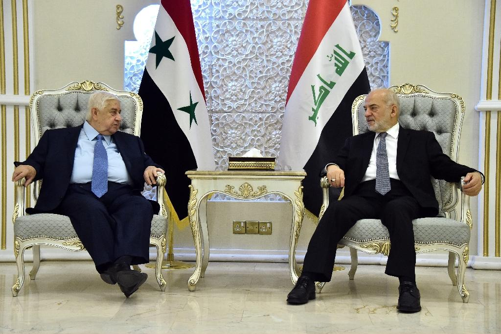 Iraqi Foreign Minister Ibrahim al-Jaafari (R) meeting his Syrian counterpart Walid Muallem in the capital Baghdad (AFP Photo/STRINGER)