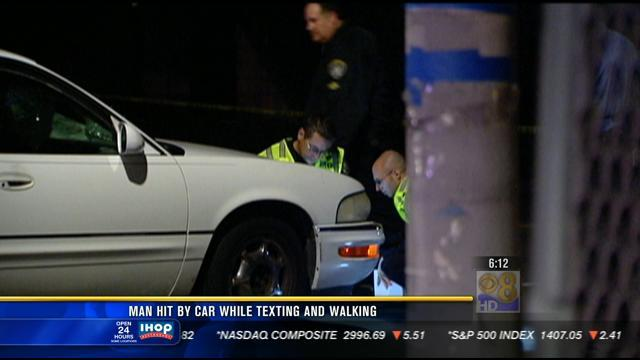 Man hit by car while texting and walking