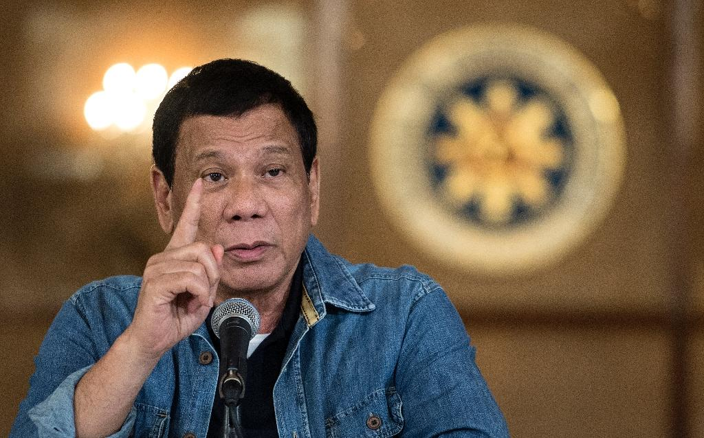 Philippines President Rodrigo Duterte took office in June 2016 and since then police have reported killing at least 2,564 people in drug raids while more than 4,200 others have been killed in unexplained circumstances (AFP Photo/Noel CELIS)