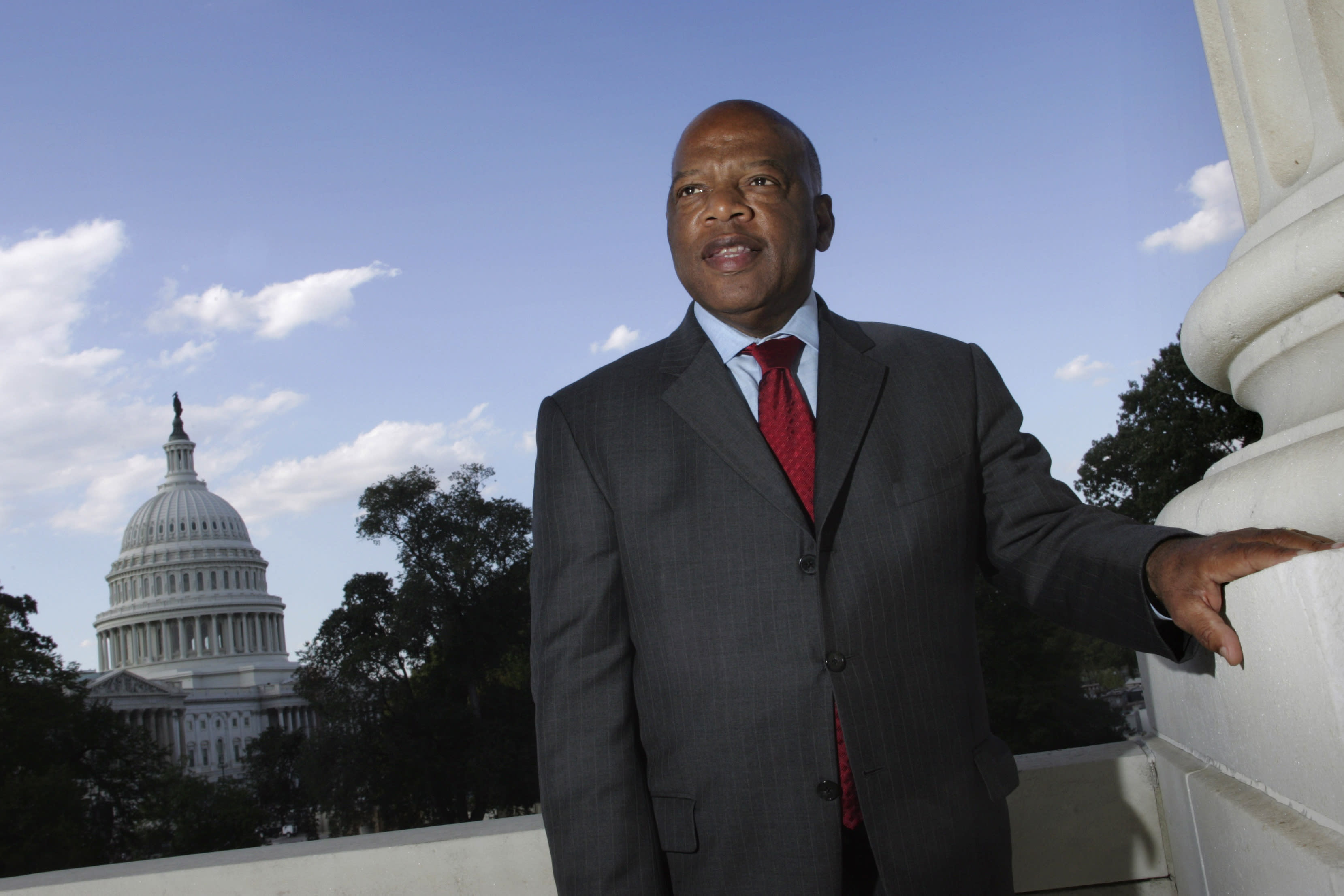 """FILE - With the Capitol Dome in the background, U.S. Rep. John Lewis, D-Ga., is seen on Capitol Hill on Oct. 10, 2007, in Washington. The success of CNN's 'RBG' film two years ago, about the late Supreme Court Justice Ruth Bader Ginsburg, led the network on a search for a similar contemporary figure whose life could be examined in historical terms. CNN's Amy Entelis says that led them to Lewis, who died of cancer in July. The film """"John Lewis: Good Trouble"""" will debut on CNN on Sunday night. (AP Photo/Lawrence Jackson, File)"""