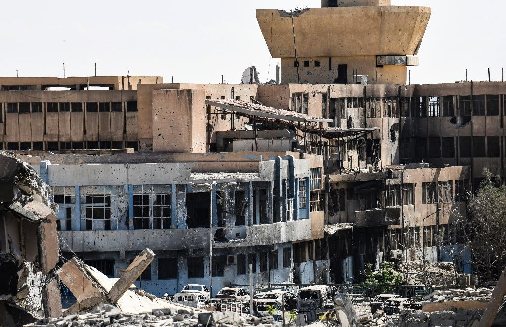 There are no functioning medical facilities in Syria's Raqa, whose central hospital is shown here on October 1, 2017 (AFP Photo/BULENT KILIC)