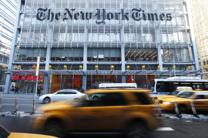Vehicles drive past the New York Times headquarters in New York March 1, 2010. Shares of the U.S. media company rose to an intraday high of $12.16 on Monday, up more than 11 percent, propelled by a rumor that Mexican billionaire Carlos Slim was seeking to buy the New York Times, where he became a minority stakeholder in 2008. Slim's spokesman has, however, said there is no change in the stake holding.  REUTERS/Lucas Jackson (UNITED STATES - Tags: BUSINESS MEDIA IMAGES OF THE DAY)