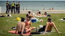 Police descend on beach crowds as Victoria records new Covid cases