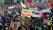 Hundreds of thousands march as France paralysed by strike