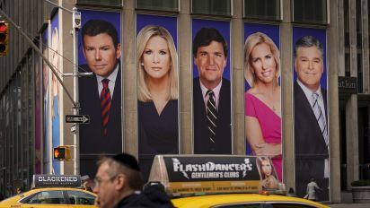 As virus surges, Fox News changes tune on masks