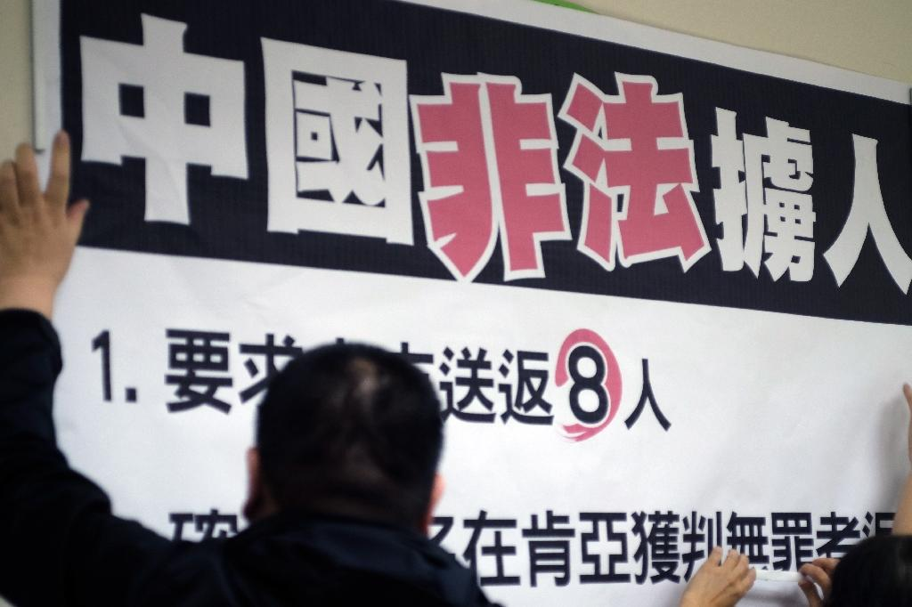 A sign reading 'China illegally abducts Taiwanese people' is seen during a press conference organized by lawmakers from the Democratic Progressive Party (DPP), at Parliament in Taipei, in April 2016