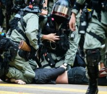 Police shoot protester, man set on fire in day of Hong Kong fury