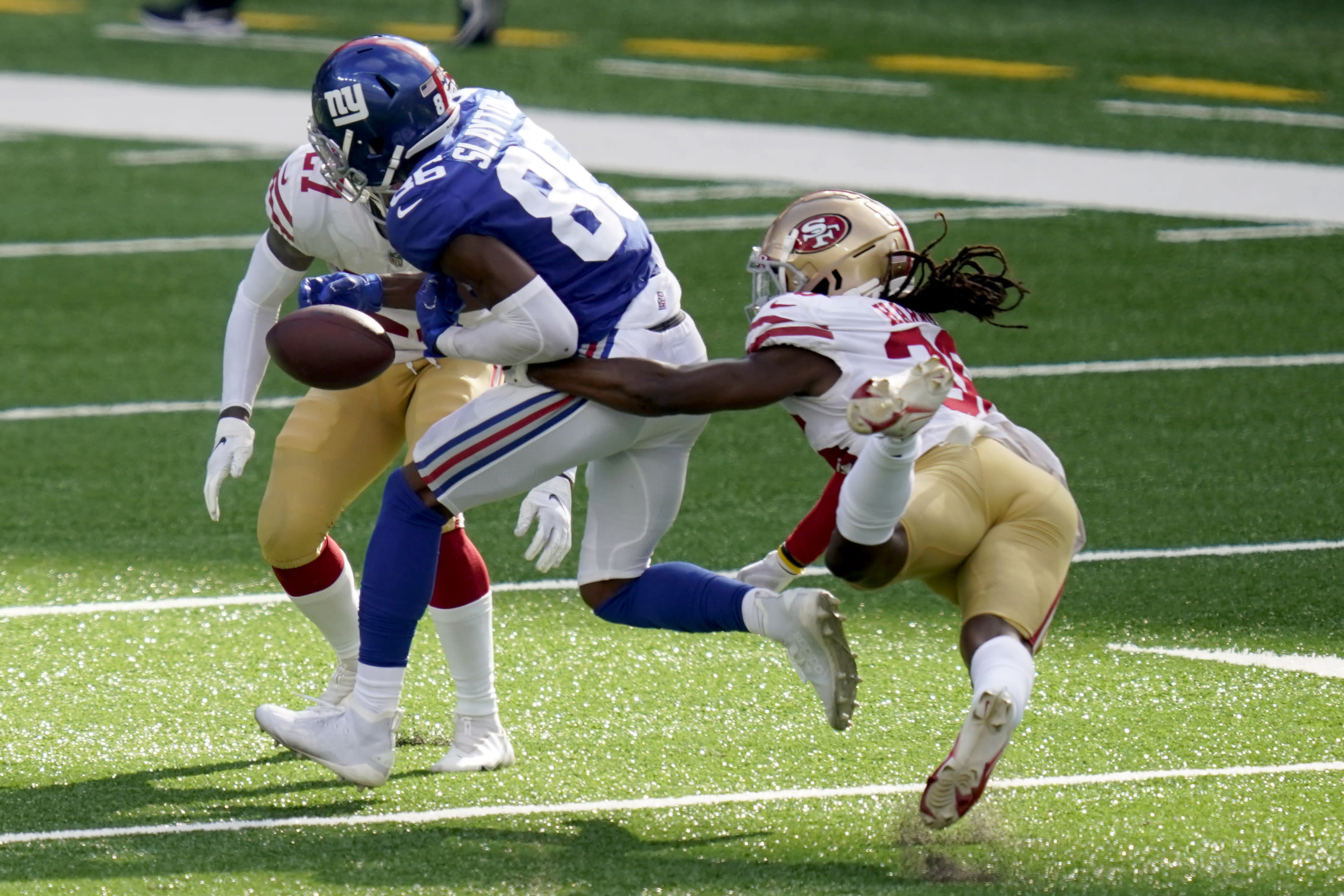San Francisco 49ers' Marcell Harris, right, punches the ball away from New York Giants' Darius Slayton during the second half of an NFL football game, Sunday, Sept. 27, 2020, in East Rutherford, N.J. (AP Photo/Corey Sipkin)
