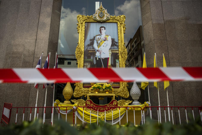 """BANGKOK, THAILAND - JANUARY 25: Police tape is put in front of a portrait of King Vajiralongkorn ahead of a pro-democracy demonstraiton lead by Parit """"Penguin"""" Chiwarak on January 25, 2021 in Bangkok, Thailand. Parit and other leaders of the protest movement gathered at the headquarters of the company that is the local producer of AstraZeneca's Covid-19 vaccine to demand transparency, (Photo by Lauren DeCicca/Getty Images)"""