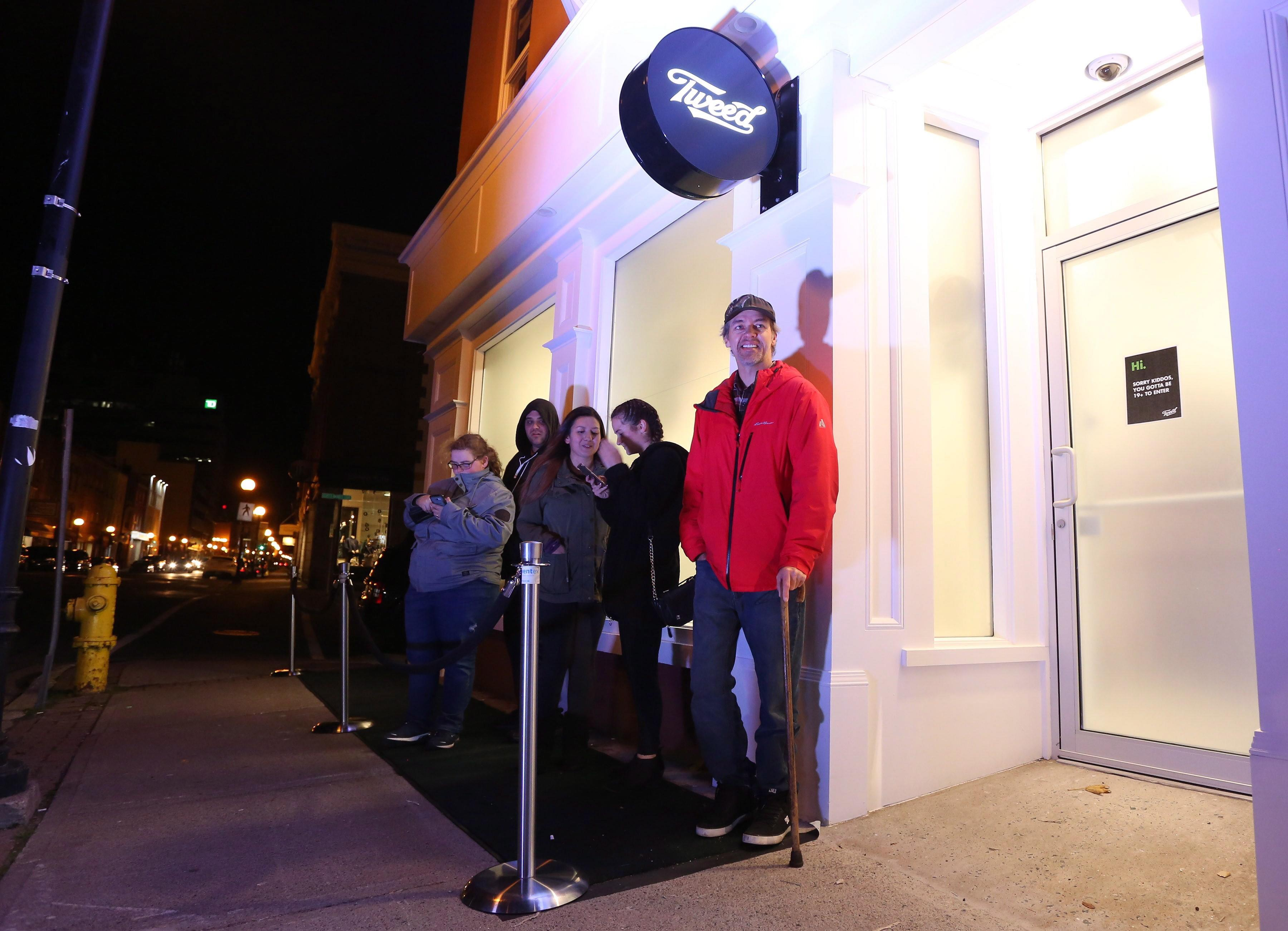 <p>Ian Power is first in line at the Tweed store on Water Street in St. John's N.L. on Tuesday, October 16, 2018. He made history and bought the first legal cannabis for recreational use in Canada after midnight.<br>(Photo from Paul Daly, The Canadian Press) </p>