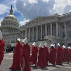 """""""Handmaids"""" staged a silent protest outside the U.S. Capitol building, and it was an eerie (and beautiful) sight"""