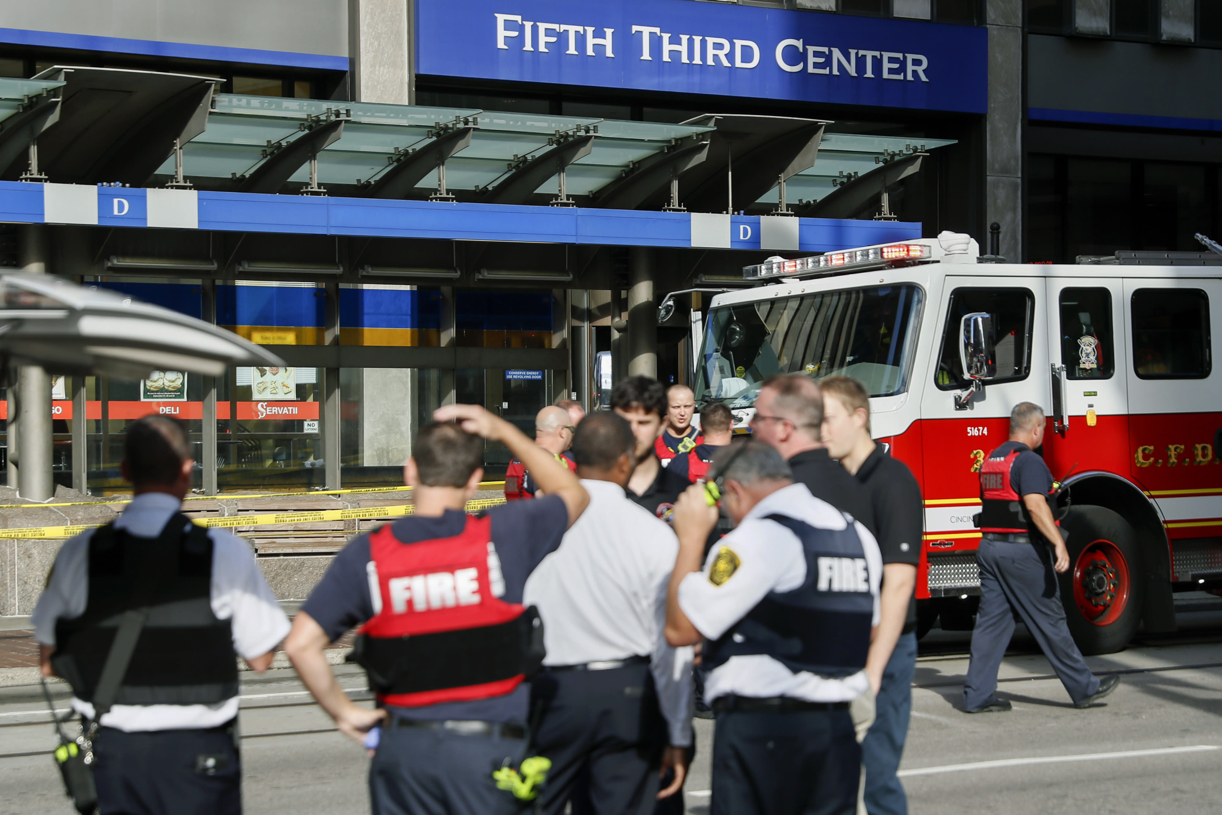 <p>Emergency personnel and police respond to reports of an active shooter situation near Fountain Square, Thursday, Sept. 6, 2018, in downtown Cincinnati. (Photo: John Minchillo/AP) </p>