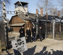Germany's Merkel voices 'shame' during 1st Auschwitz visit