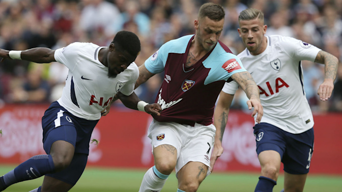 Hot start helps Spurs hold off Hammers after red