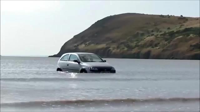 Teen's car submerged in the sea during heatwave