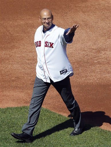 Former Boston Red Sox manager Terry Francona walks onto the field during ceremonies to celebrate the 100th anniversary of the first regular season baseball game at Fenway Park, before a game between the New York Yankees and the Red Sox in Boston, Friday, April 20, 2012. (AP Photo/Michael Dwyer)