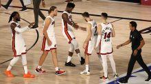 Heat take 2-0 lead over Bucks in controversial finish, Rockets advance