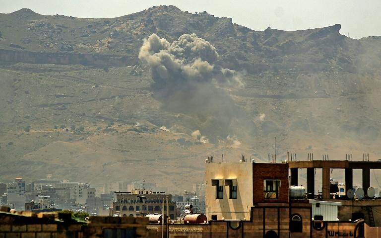 Smoke billows following a reported airstrike by the Saudi-led coalition in the Yemeni capital Sanaa, on July 1 (AFP Photo/MOHAMMED HUWAIS)