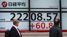Asian markets rise pending US midterm election results