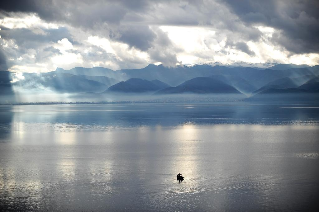Environmental activists say Macedonia's Lake Ohrid is under threat because development plans could destroy a 50-hectare (120-acre) wetland serving as a crucial natural filter to the lake (AFP Photo/ARMEND NIMANI)