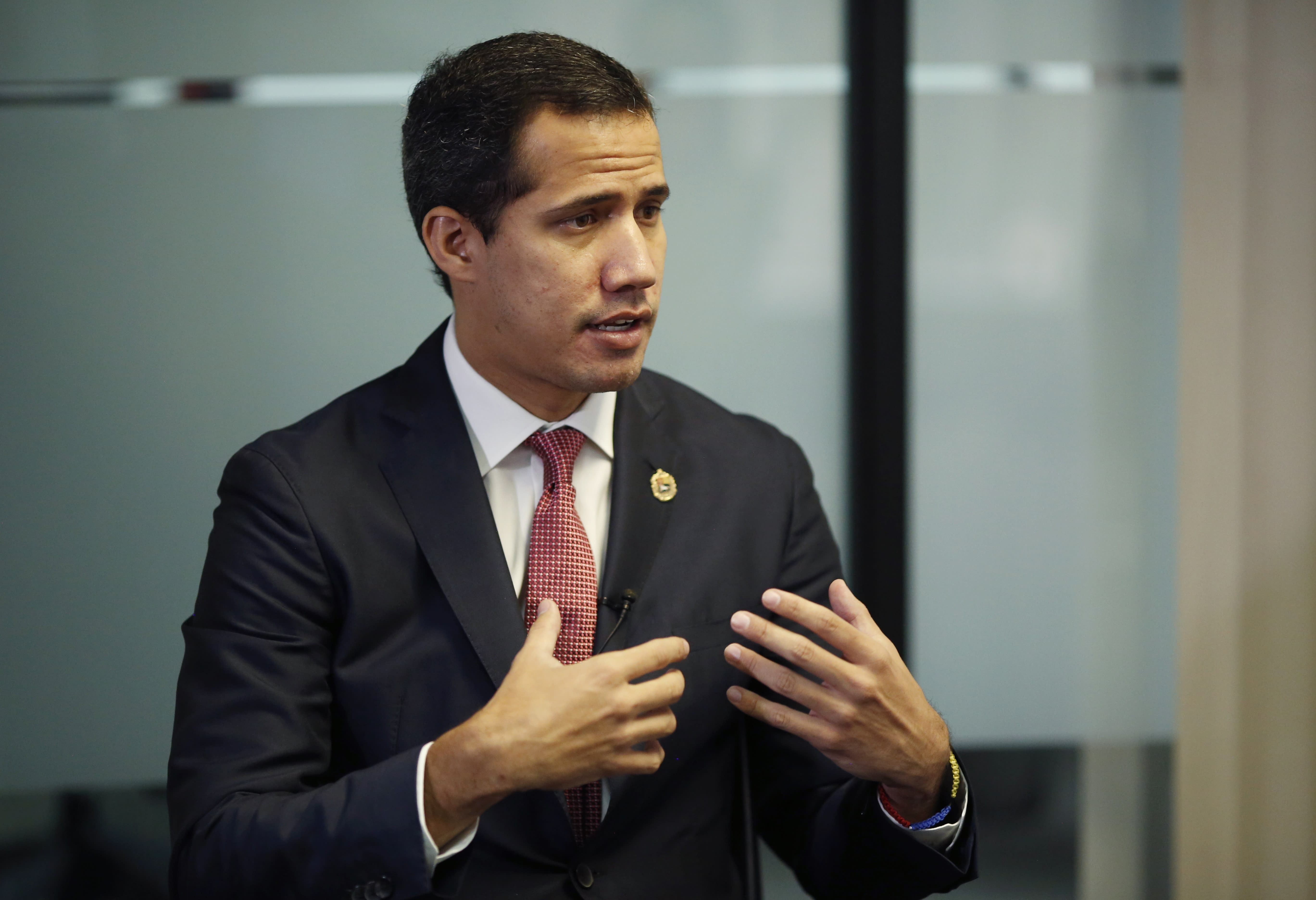 Venezuela's National Assembly President and self proclaimed interim President Juan Guaido speaks during a interview with the Associated Press in Caracas, Venezuela, Friday, Aug. 23, 2019. Guaido said that opponents of President Nicolas Maduro won't participate in any early legislative elections he calls amid a protracted power struggle in the crisis-stricken nation and that participating in any election with the Maduro government still in power would be a farce. (AP Photo/Leonardo Fernandez)