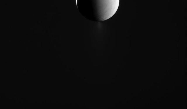 The Big Picture: Saturn illuminates the surface of its icy moon