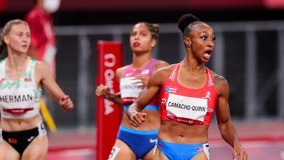 Bear's sister sets 100M hurdles Olympic record