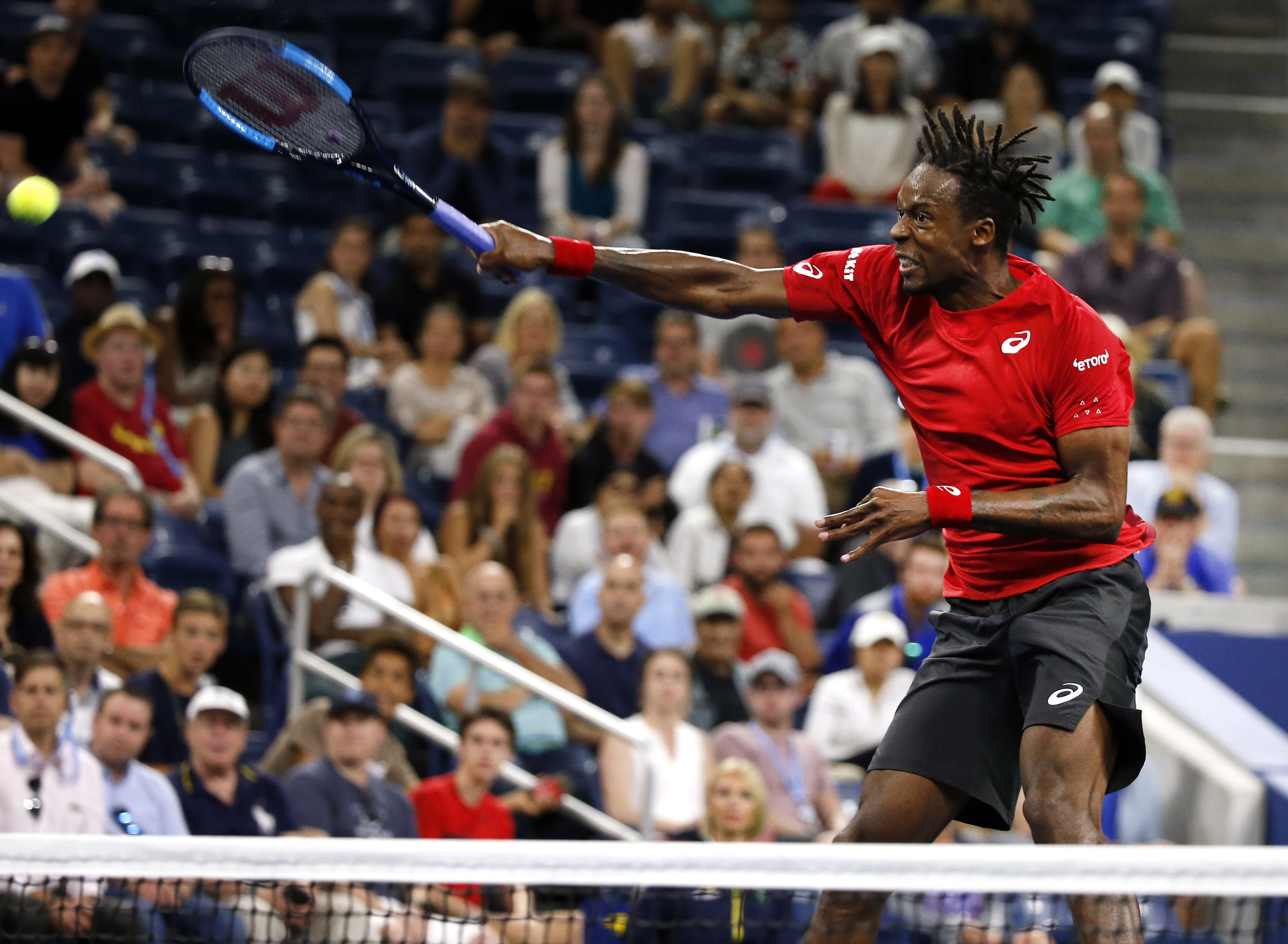 Gael Monfils, of France, returns a shot near the net to Denis Shapovalov, of Canada, during the third round of the U.S. Open tennis tournament Saturday, Aug. 31, 2019, in New York. (AP Photo/Jason DeCrow)
