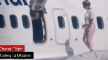 Watch: Woman Walks on Aircraft Wing after Feeling 'Too Hot' in Ukraine