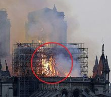 Woman claims to spot Jesus in photo of flaming Notre Dame Cathedral roof