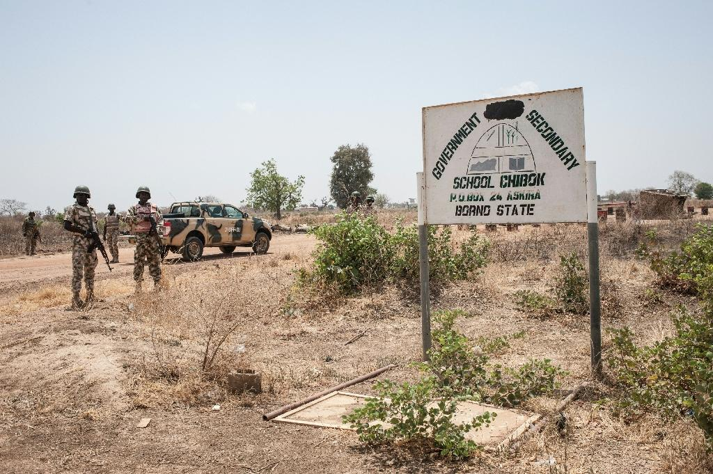 Soldiers from the 7th Division of the Nigerian Army stand outside the Government Girls Secondary School Chibok in Borno State north-eastern Nigeria on March 25, 2016 (AFP Photo/Stefan Heunis)