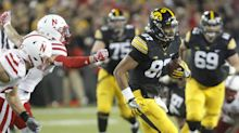 Man charged after allegedly threatening Iowa TE with gun at a park