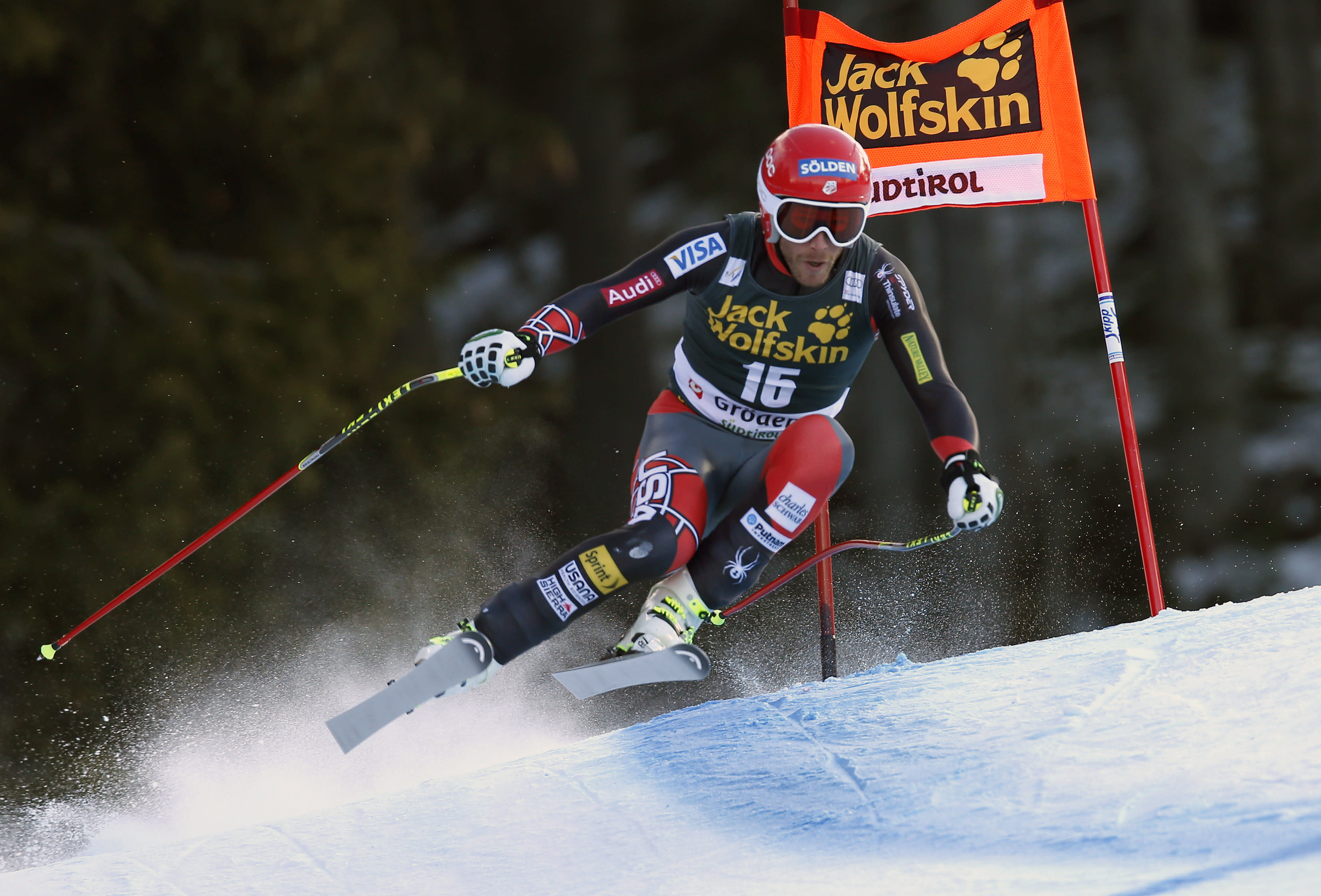Bode Miller, of the United States, competes during an alpine ski, men's World Cup downhill, in Val Gardena, Italy, Saturday, Dec. 21, 2013. Jansrud finished in second place. (AP Photo/Marco Trovati)